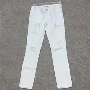 Size 1 white Dollhouse skinny jeans with rips